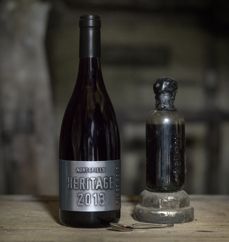 Close up Auntsfield Heritage Pinot Noir 2013 next to David Herd's original Auntsfield Muscat 1905 in cellar door
